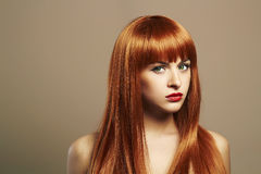 Beauty hair Girl. Healthy Red Hair. Beautiful Young Woman Royalty Free Stock Images