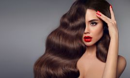 Beauty hair girl portrait. Red lips makeup, manicure nails and h royalty free stock image