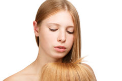 Beauty of hair. Young beautiful woman with long blond hair isolated on white background Stock Images