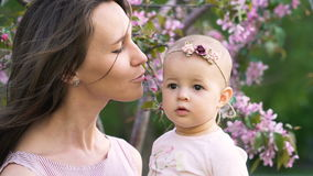 Beauty happy couple mum and infant have fun slowmotion closeup stock footage