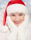 Beauty happy girl in Christmas hat and mittens Stock Image