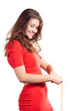 Beauty happy while measuring her waist Stock Image