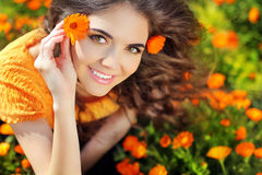 Beauty Happy Romantic Woman Outdoors. Beautiful Teenage Girl Embracing In Golden Marigold Flowers Royalty Free Stock Photos