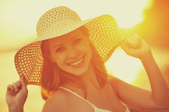 Beauty happy smiling woman in hat at sea at sunset on beach Royalty Free Stock Images