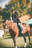 Beauty happy woman with horse stock photo