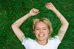 Beauty happy woman lie grass Stock Images