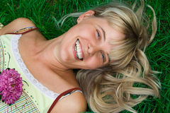 Beauty happy woman lie grass Stock Photo
