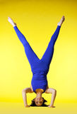 Beauty happy yoga master stand on head Royalty Free Stock Photography