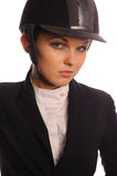 Beauty haughty strict jockey. Close up portrait of beauty haughty strict jockey, isolated on white Royalty Free Stock Images