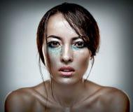 Beauty head shot of a woman with heavu makeup Stock Images