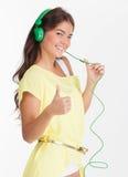 Beauty in headphones. Stock Photos