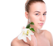 Beauty of health young woman with lily Stock Images