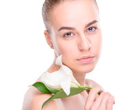 Beauty of health young woman with lily Stock Photos