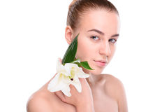 Beauty of health young woman with lily looking at Royalty Free Stock Photo