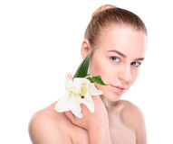 Beauty of health young woman with lily looking at Royalty Free Stock Images