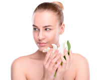 Beauty of health young woman posing with lily Royalty Free Stock Photo