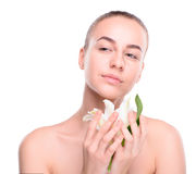 Beauty of health young woman posing with lily Royalty Free Stock Image