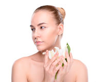 Beauty of health young woman posing with lily Royalty Free Stock Images