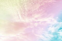 Beauty high fluffy abstract clouds blue sky background fresh air in sunny day. colorful gradient rainbow green pink yellow violet
