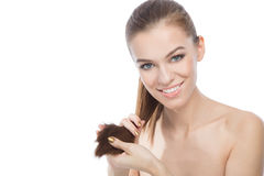 Beauty holding the ends of her hair Royalty Free Stock Images