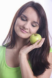 Beauty holding green apple near her cheeck Royalty Free Stock Image