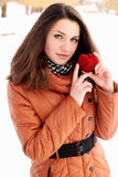 Beauty holding a red heart Royalty Free Stock Image