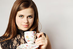 Beauty holds cup tea Royalty Free Stock Photo