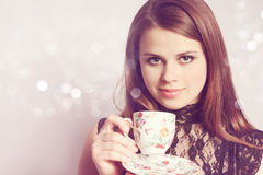 Beauty holds cup tea Royalty Free Stock Image