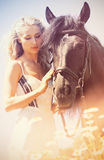 Beauty with horse Stock Photography