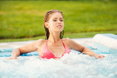 Beauty in hot tub. Stock Photography
