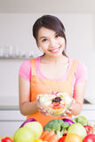 Beauty housewife in kitchen. Beauty housewife hold salad in the kitchen Stock Photo