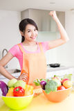 Beauty housewife in kitchen Stock Photo