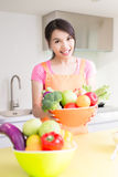Beauty housewife in kitchen Stock Image