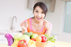 Beauty housewife in kitchen Stock Photos