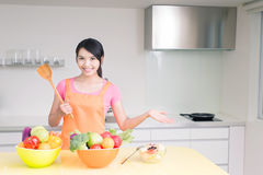 Beauty housewife in kitchen Stock Images