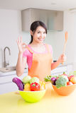 Beauty housewife in kitchen. Beauty housewife take rice spoon in the kitchen Royalty Free Stock Photo
