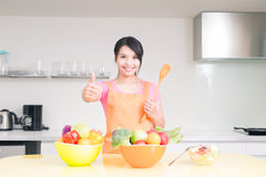 Beauty housewife in kitchen. Beauty housewife take rice spoon in the kitchen Royalty Free Stock Photos