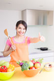 Beauty housewife in kitchen. Beauty housewife take rice spoon in the kitchen Stock Photos