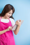Beauty housewife take tablet Royalty Free Stock Photo