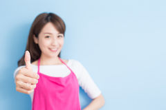 Beauty housewife thumb up Stock Photography