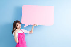 Beauty housewife thumb up. Beauty housewife take speech bubble billboard and thumb up isolated on blue background stock photo