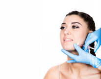 Beauty injection by doctor in blue gloves. Young woman in beauty salon. free space for text
