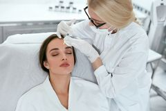 Beauty Injections. Woman On Rejuvenation Procedure In Clinic stock photo