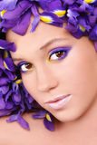 Beauty with irises Stock Images