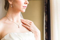 Beauty and jewelry concept - woman wearing shiny diamond pendant Royalty Free Stock Photography