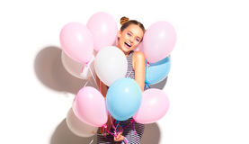 Beauty joyful teenage girl with colorful air balloons having fun. Isolated on white Stock Images