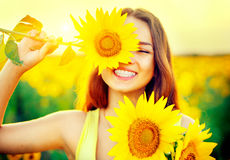 Beauty joyful teenage girl with sunflower. Enjoying nature Royalty Free Stock Photos