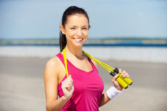 Beauty with jumping rope. Royalty Free Stock Photography