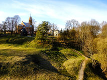 Beauty of Kernave Hills in Lithuania. Kernave Hills near the Capital City of Lithuania and the Church in the Horizon Stock Photo
