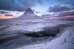 Beauty Kirkjufell mountain with water falls at winter, Iceland Royalty Free Stock Image